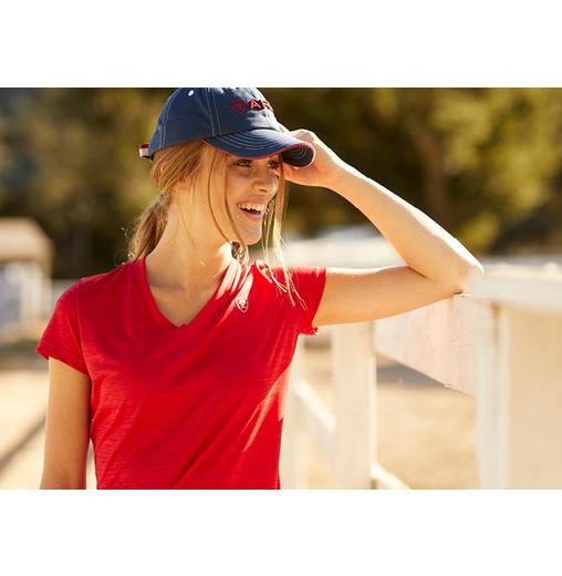 Woman in Ariat hat and red T-shirt