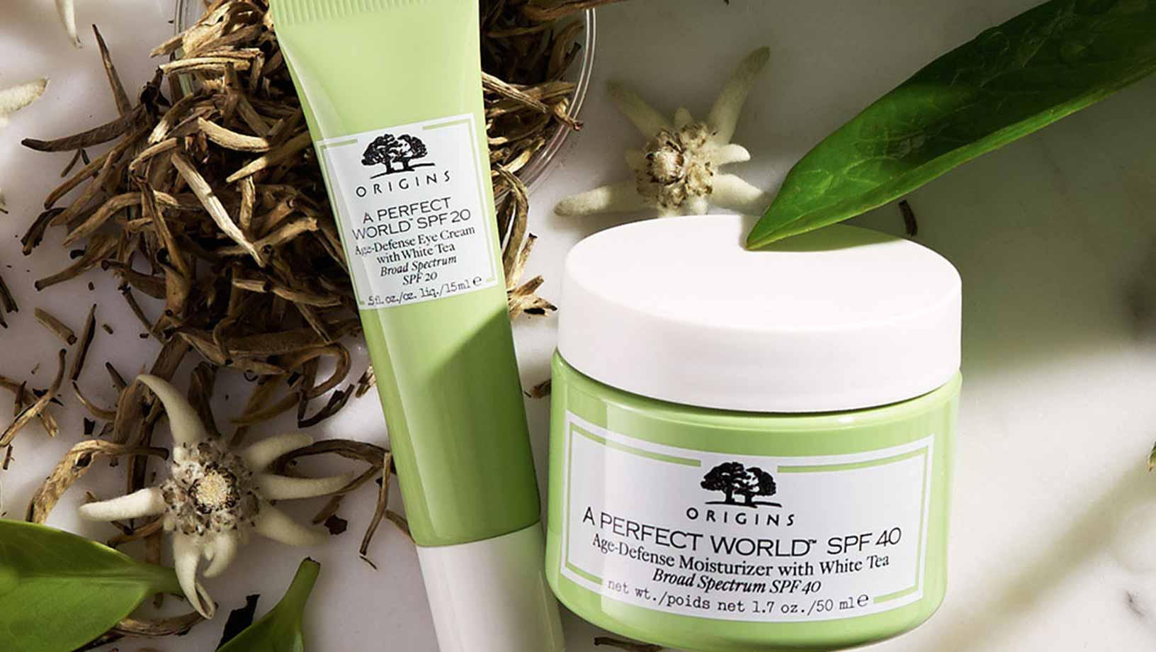 Origins oil-free SPF 40 moisturizer and Eye Cream on a marbel counter with dried white tea and green leafs in the background