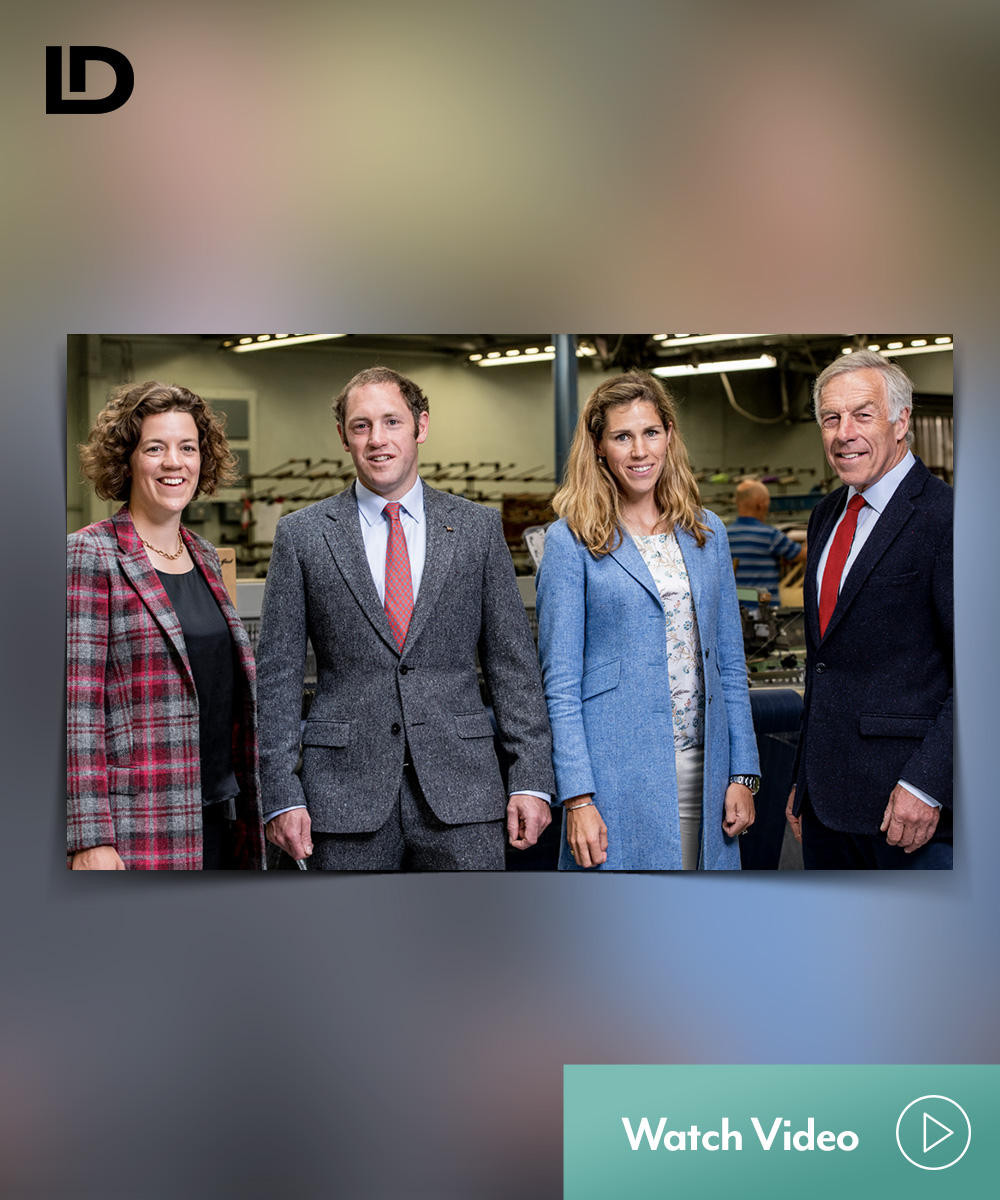 4 well dressed Magee Employees in the factory