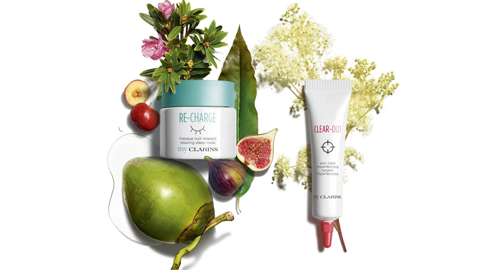 My Clarins Re-Charge and My Clarins Clear-Out on a white background surrounded by wild flowers, figs, and other green and red fruit