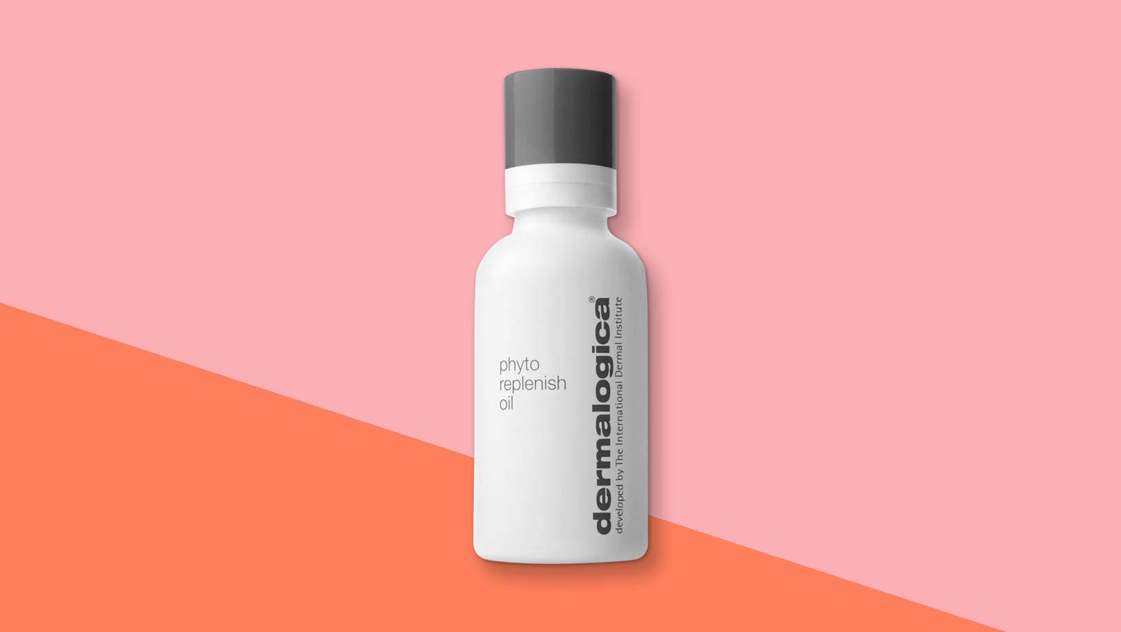 Dermalogica Phyto Replenish Oil standing on a pink and orange background