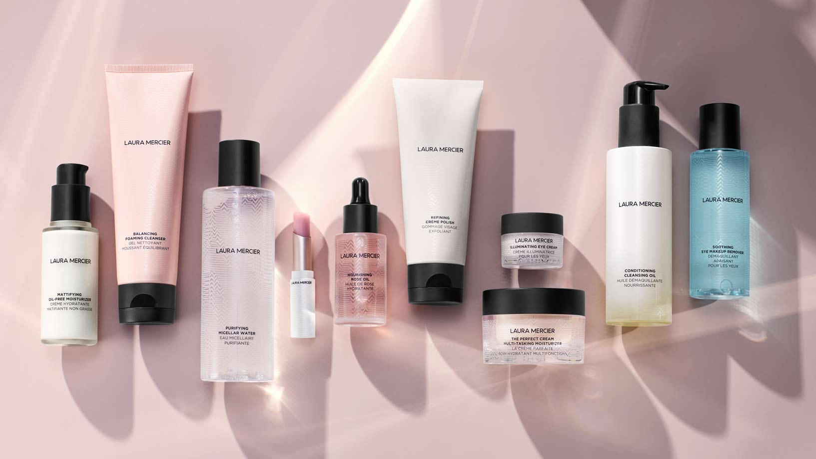 Laura Mercier products on pink background