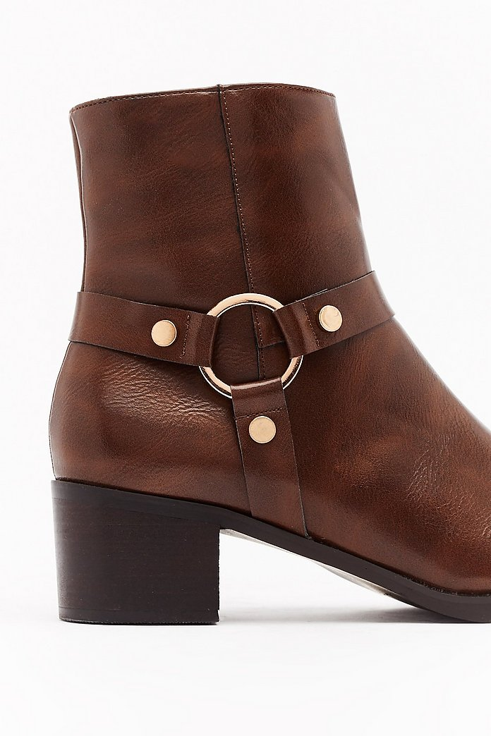 brown leather harness ring boots