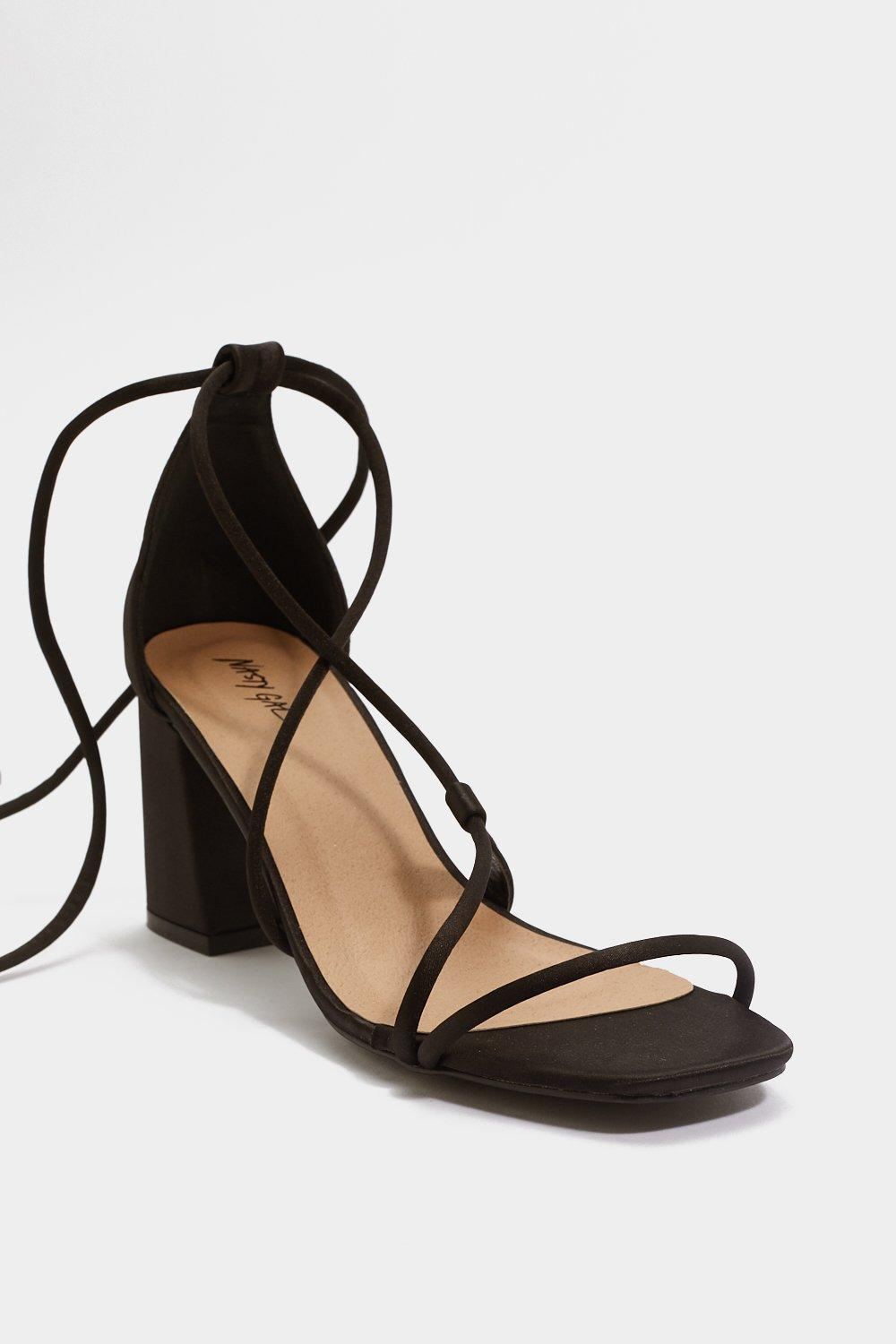 45233944b62a Womens Black Strapped in Wrap Heels. Hover to zoom