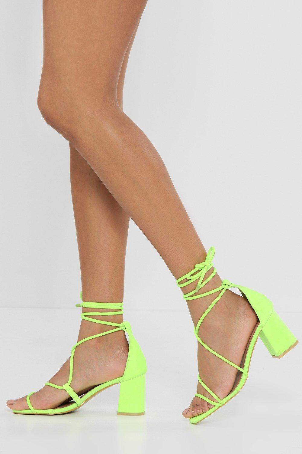55a56f3adea Strapped in Wrap Heels. Hover to zoom