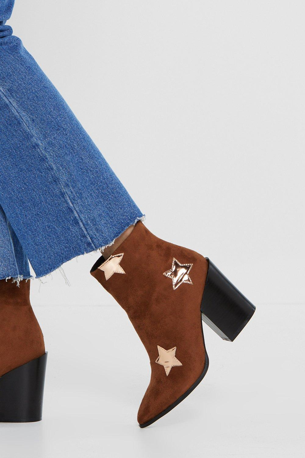 31b25c225fe6 ... High the Moon Star Ankle Boot. Hover to zoom