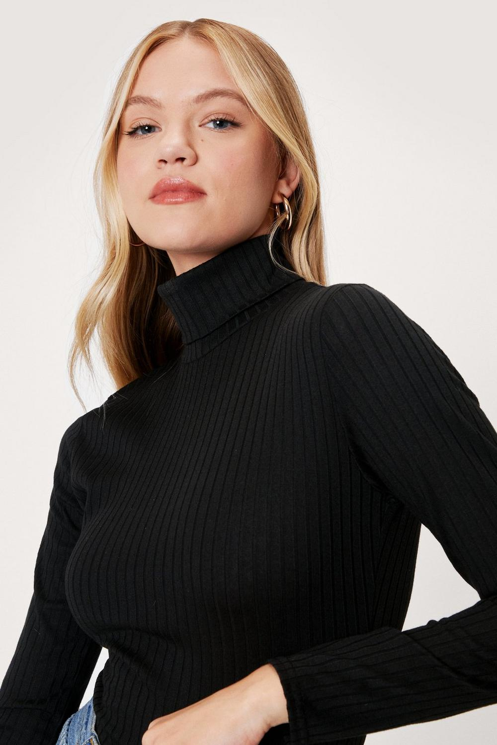 8ca9a90fa1 Womens Black Roll With It Ribbed Turtleneck Sweater. Hover to zoom