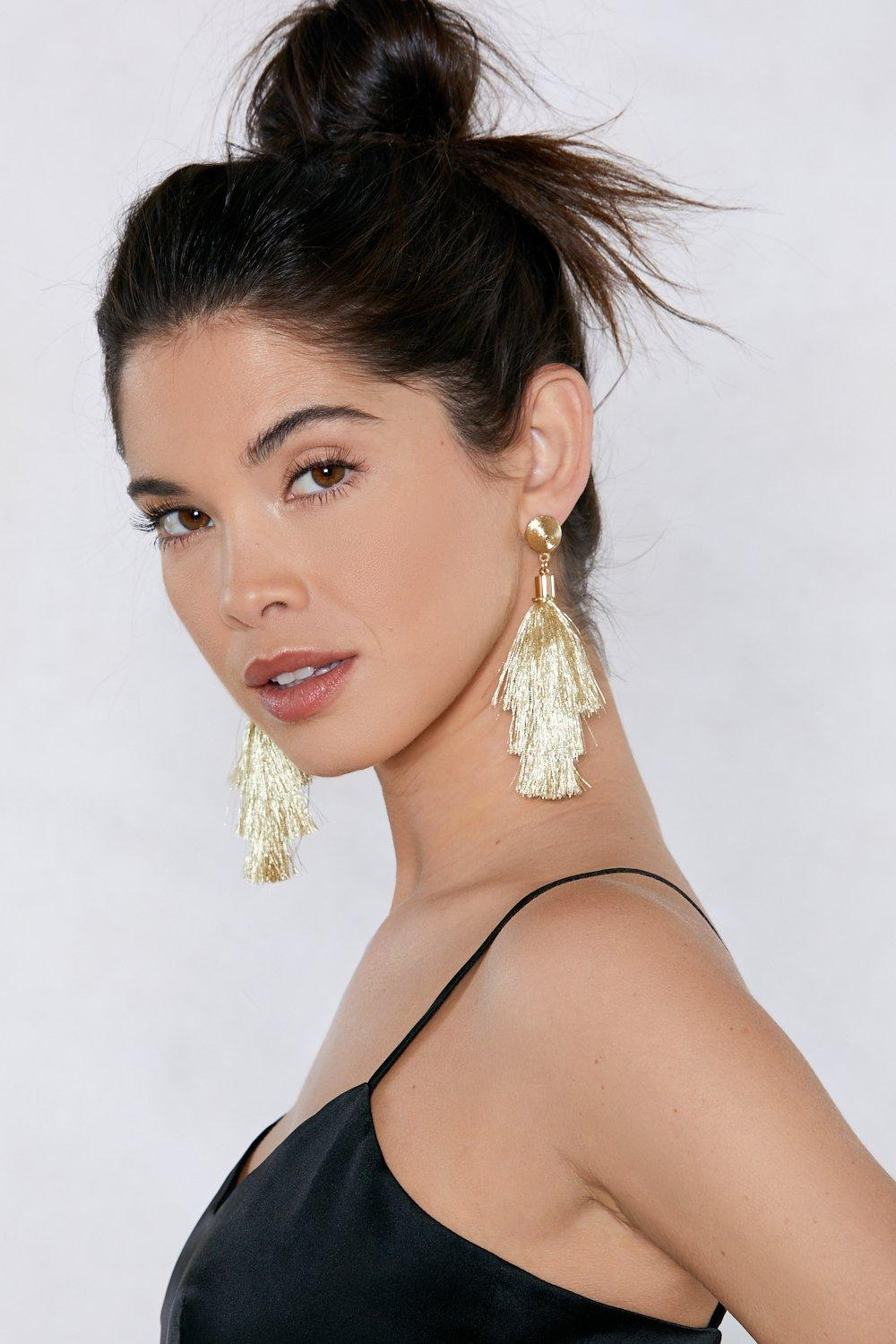 of online stock picture with earrings woman