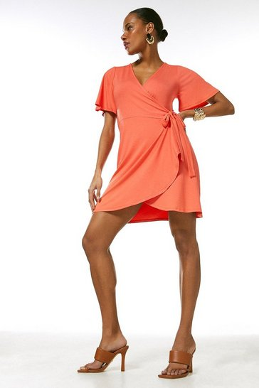 Coral Angel Sleeve Tie Wrap Jersey Dress