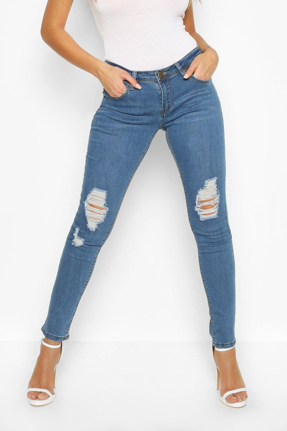 c7b488176b60 Womens Blue Mid Rise Distressed Rip Knee Skinny Jeans. Hover to zoom. Close  video