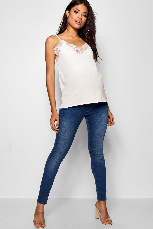 ebcd3c3e1 Jeans skinny por encima de la barriga rasgados Premamá