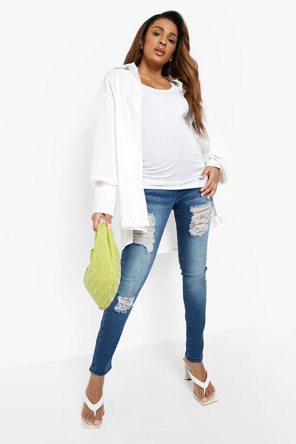 11eb20a5b Jeans skinny por encima de barriga rasgados premamá