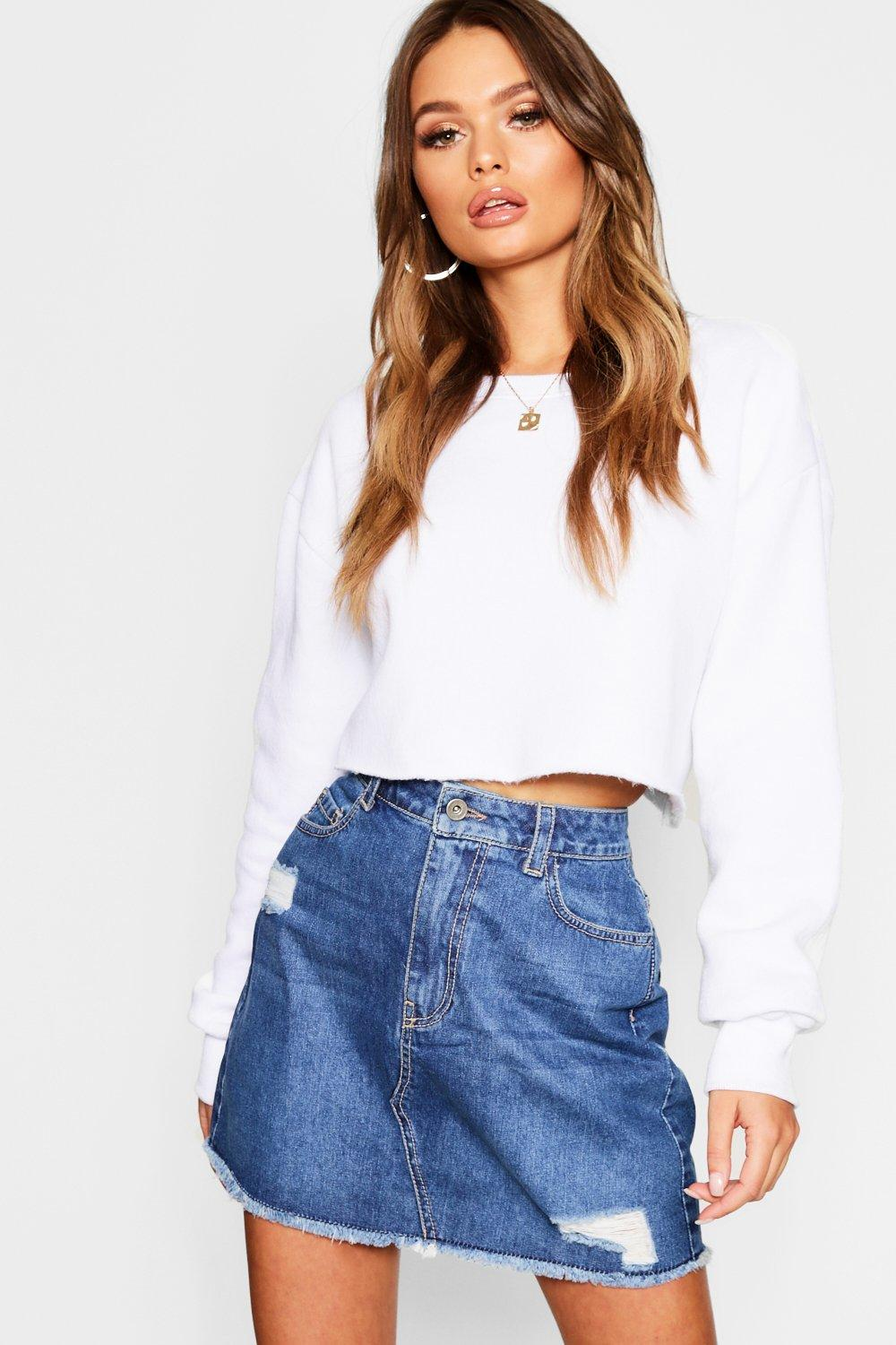 b6e0cabd77 Ripped Distressed Denim Mini Skirt. Hover to zoom