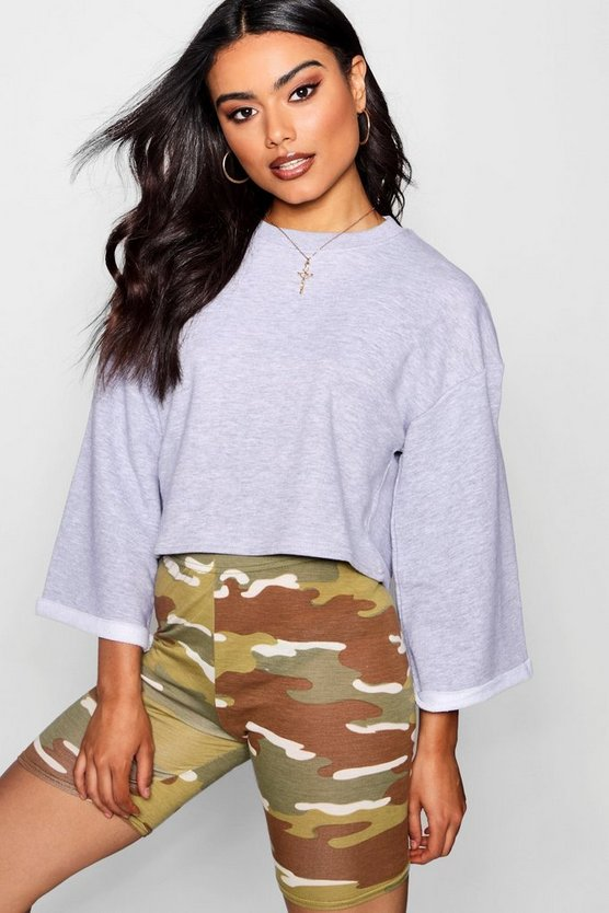 Raw Edge Sleeve Crop Sweat Top