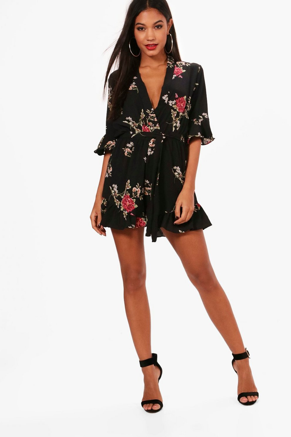642ee802fb80 Floral Ruffle Sleeve Wrap Over Playsuit | Boohoo