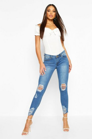 Womens Mid blue Mid Rise Distressed Knee And Ankle Skinny Jeans