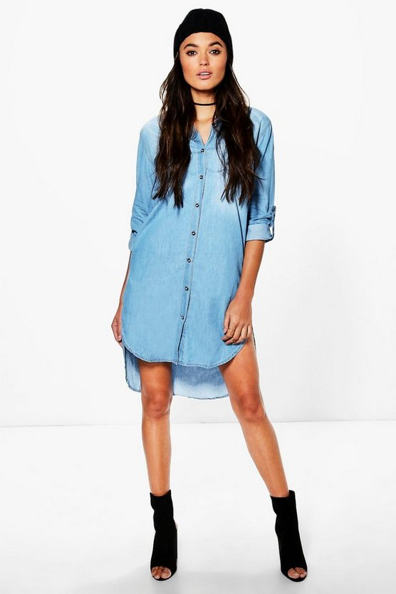 The little denim dress you never knew you always needed. This light-wash design makes haute easy—just add jewels or a belt and you're (so very) good to go. Button closure. Front pockets. 3/4-sleeves. Regular length: 40