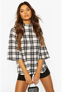 Nude Check Puff Shoulder Roll Neck Swing Top