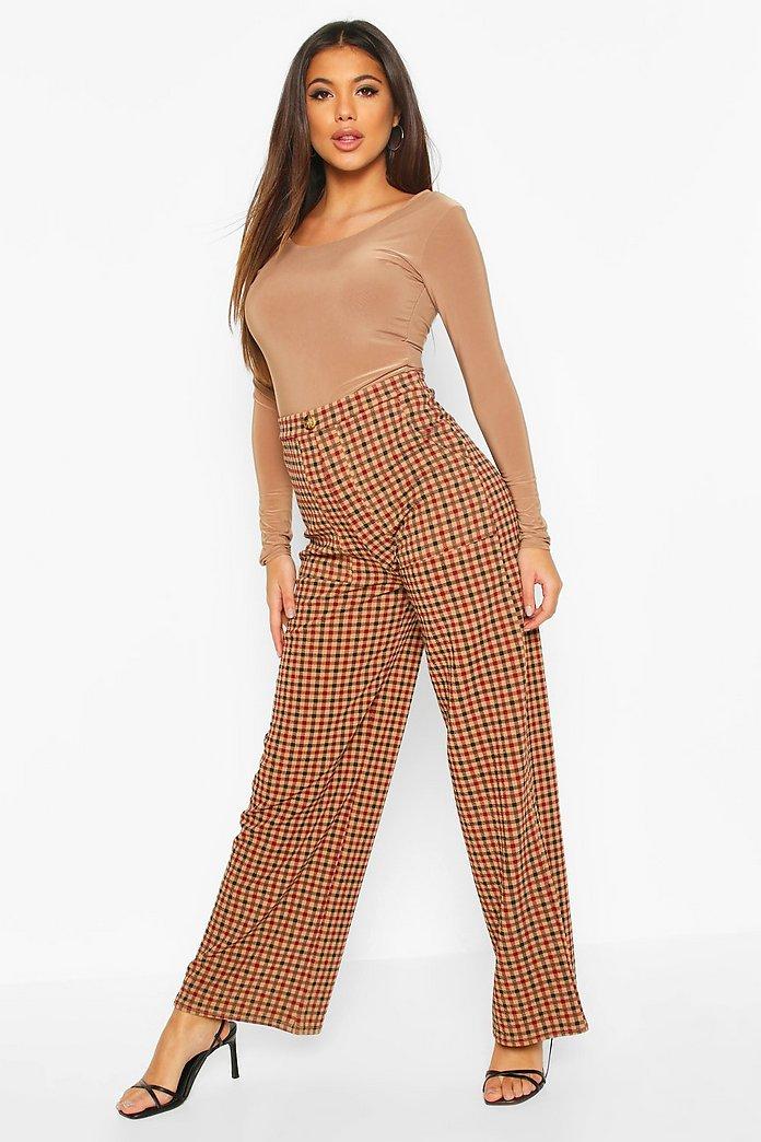 Rutiga byxor med fickor och vida ben | boohoo