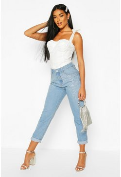 High-Rise Mom-Jeans in Used-Optik mit Strasssteinen, Mittelblau