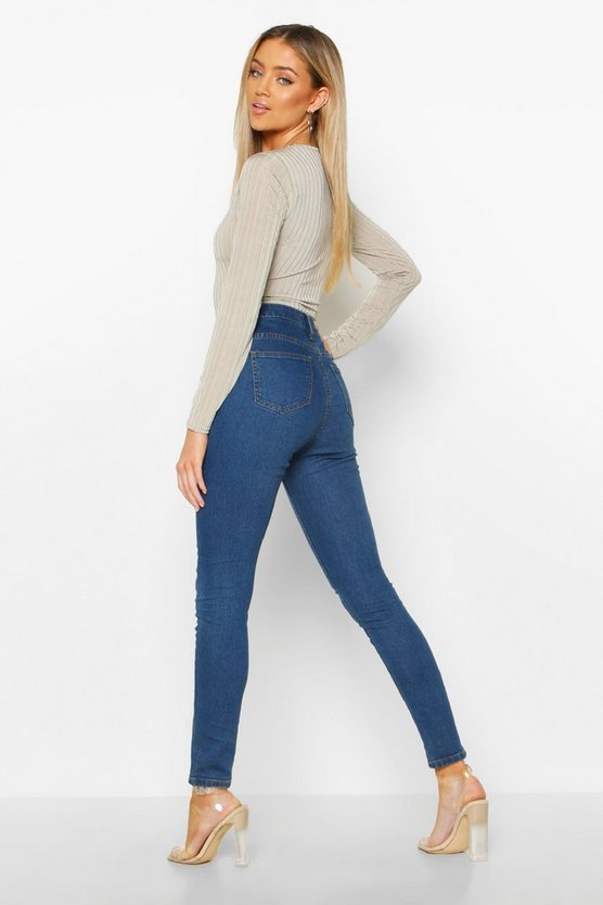 Exposed Button Front High Rise Skinny Jean