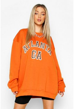 "Burnt orange ""Atlanta"" oversize sweatshirt med slogan"