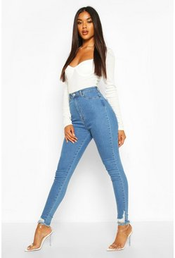 Jean skinny Power Stretch à ourlet effiloché, Bleu clair
