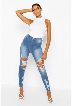 High-Rise Skinny Jeans aus Powerstretch im Destroyed-Look, Hellblau