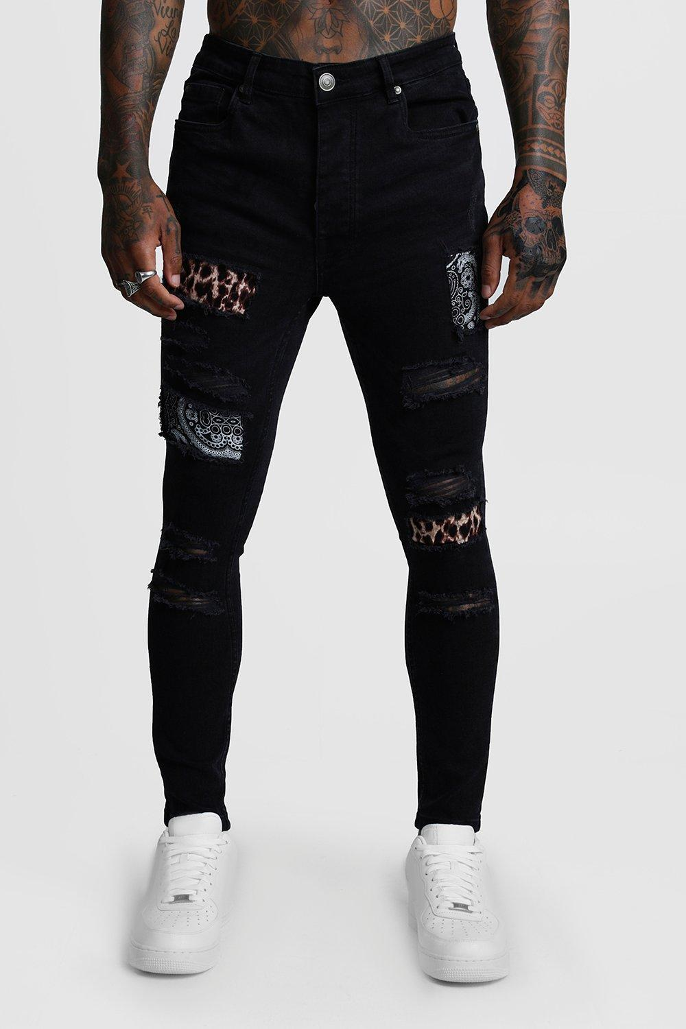 Distressed Jeans With Printed Patch | boohoo