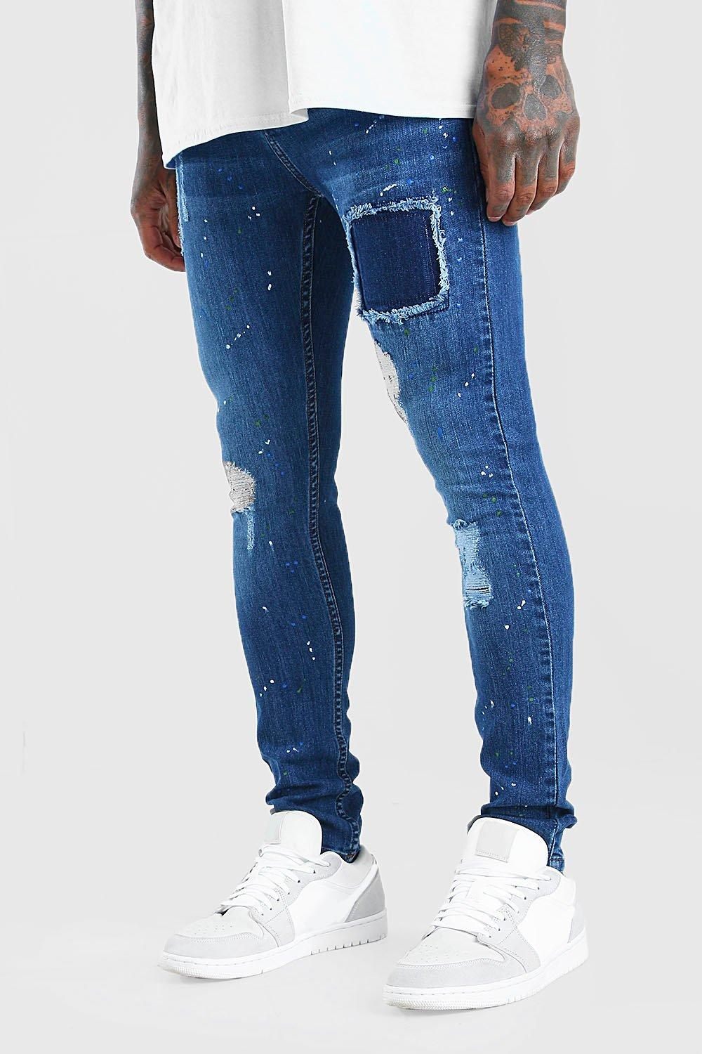 mens super skinny distressed jeans with paint splatter - blue