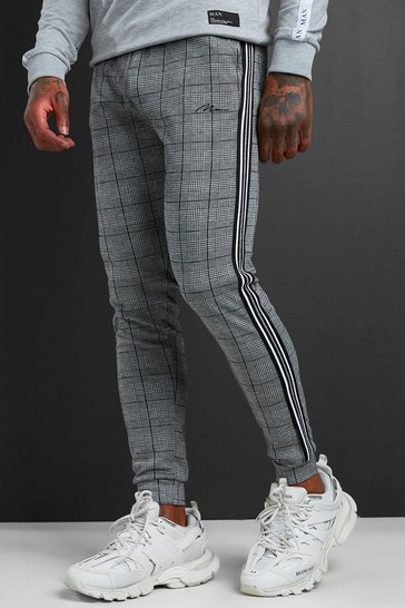 Black MAN Signature Jacquard Cuff Joggers With Tape