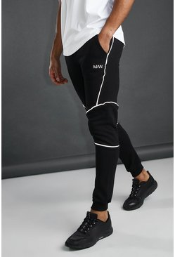 MAN Active Tapered-Fit Jogginghosen mit Paspelierung, Schwarz