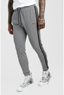 Black MAN Signature Jacquard Cuffed Jogger With Tape