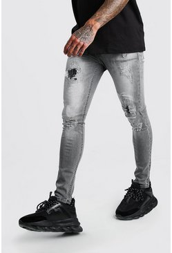 Super Skinny Jeans im Destroyed-Look mit Rip-and-Repair-Elementen, Grau
