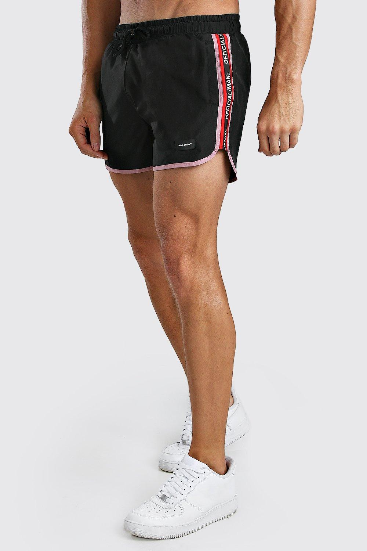 60s – 70s Mens Bell Bottom Jeans, Flares, Disco Pants Mens MAN Official Runner Trunks With Tape - Black $22.00 AT vintagedancer.com