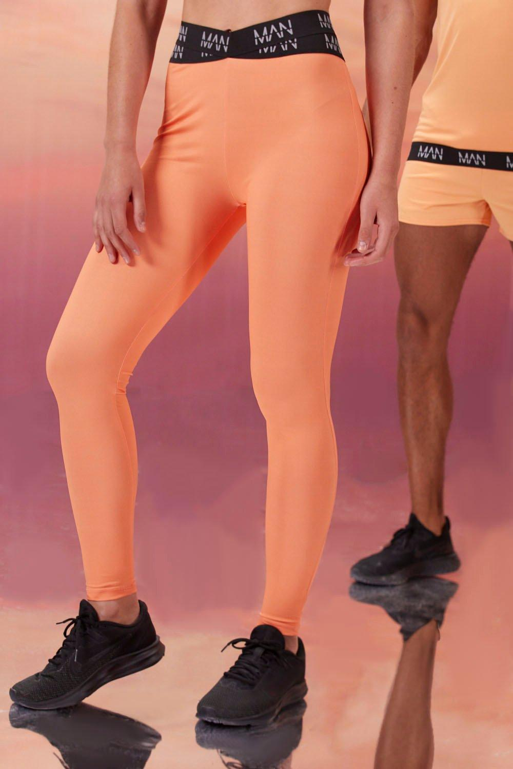mens hers active tight with cross waistband detail - orange