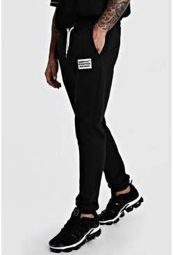 MAN Worldwide Skinny Fit Jogginghose, Schwarz, Herren