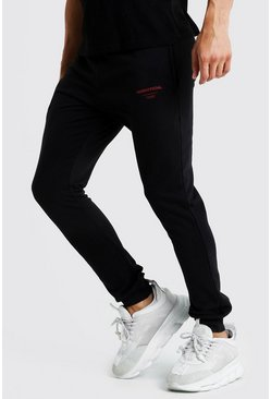 Pantaloni tuta slim fit con stampa MAN Official, Nero, Maschio