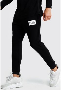 MAN Official International Print Slim Fit Joggers, Black, HOMBRE