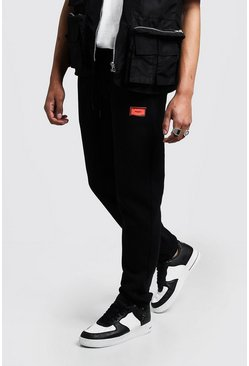 Mens Black Skinny Fit Rubber MAN Badge Jogger With Toggle