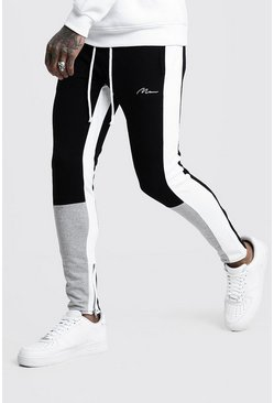 Skinny Fit Jogginghose mit MAN Signatur im Colorblock-Design, Grau