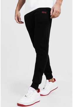 Joggings skinny brodé trait MAN, Noir, Homme