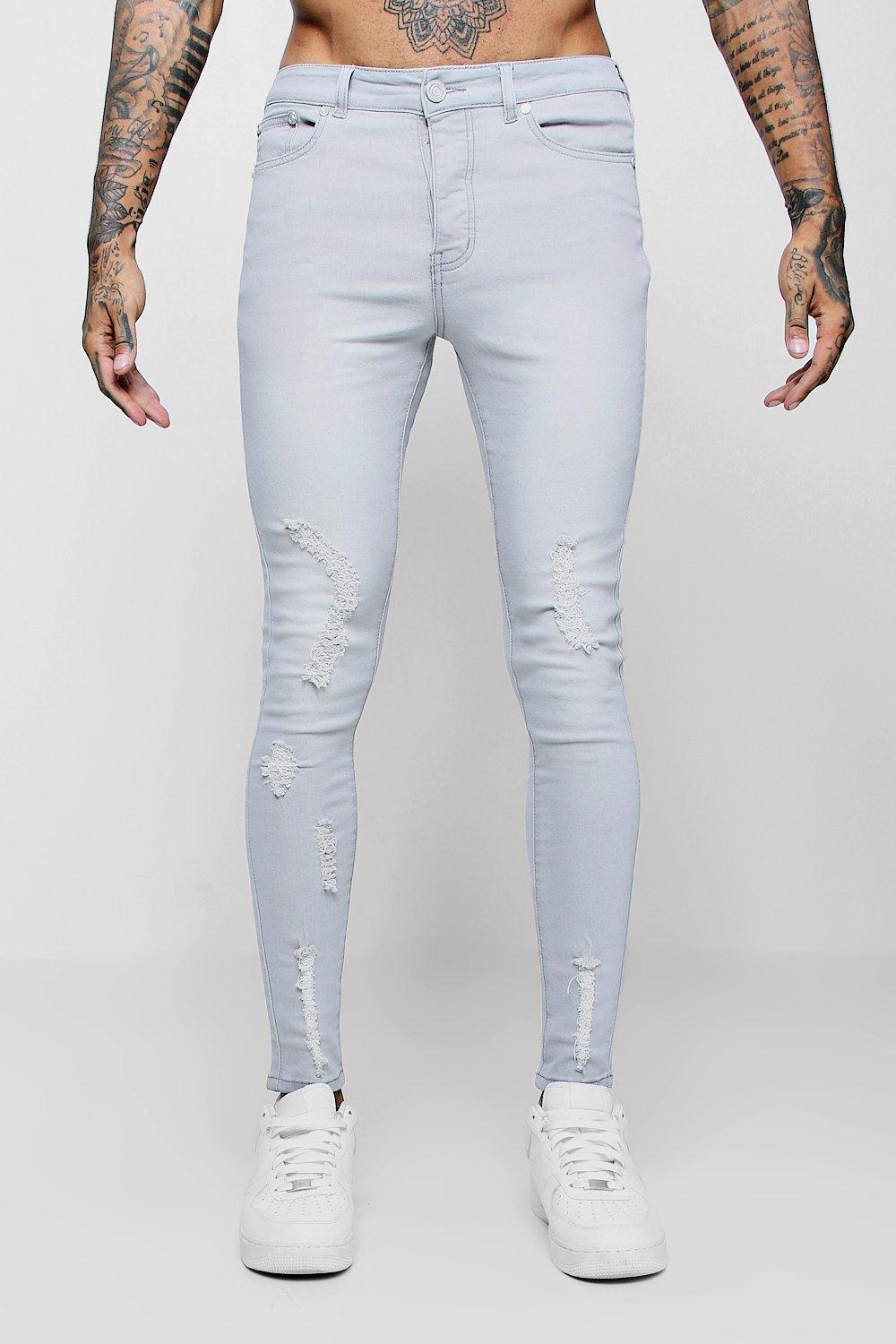 Spray on Skinny Jeans with All Over Rips