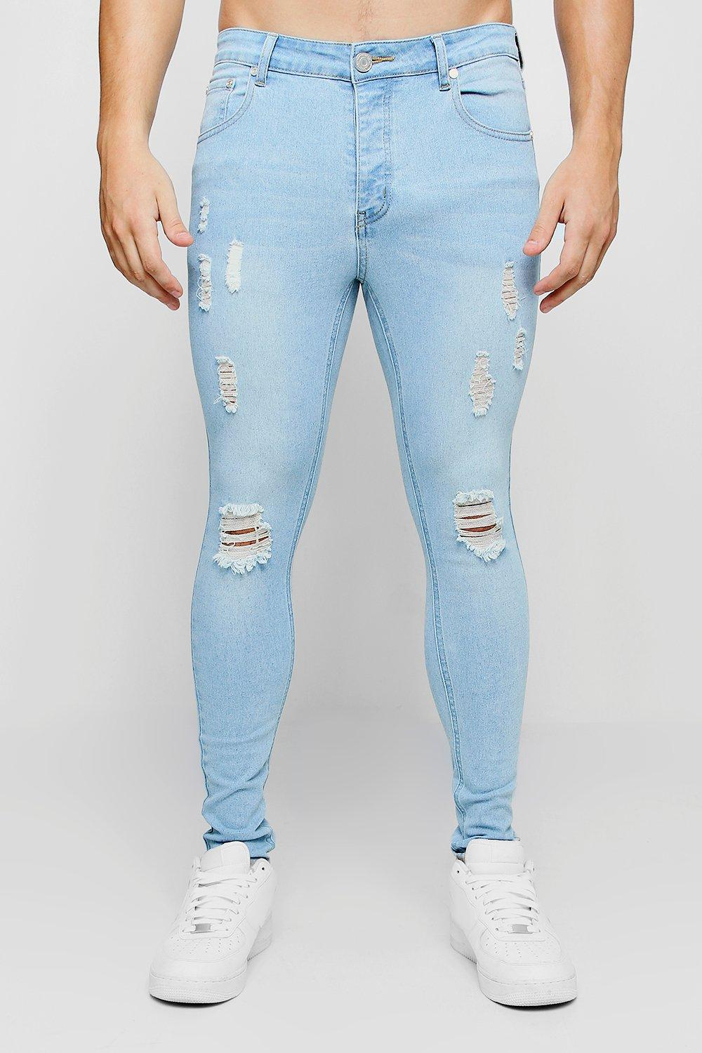 Ripped Knee Spray On Skinny Jeans