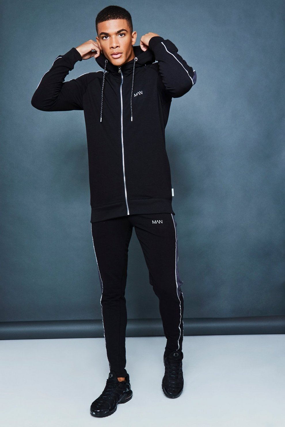 e1c31243e6 Muscle Fit Panelled Reflective Detail Tracksuit | Boohoo