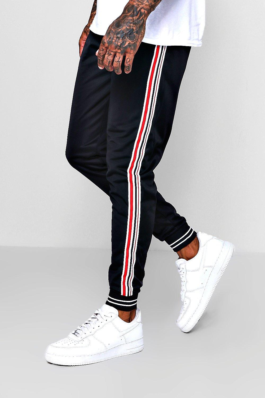 Pantalones de correr de jersey con bajos entallados y raya lateral | boohoo