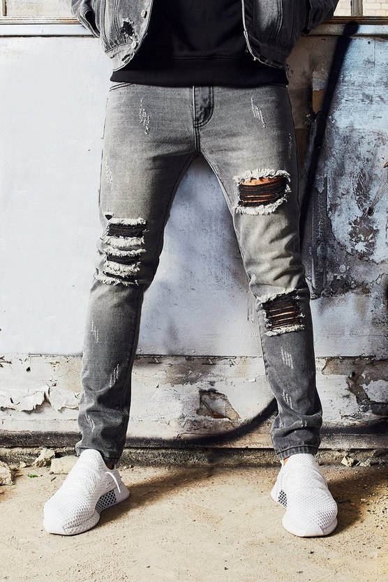 Dele Skinny Fit Jeans With Heavy Distressing