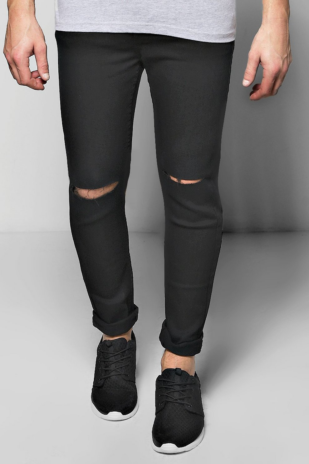 4fb34d20385c0 jean skinny effet spray noir déchiré aux genoux | Boohoo
