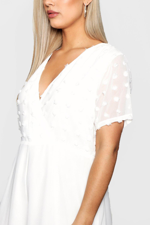 dbb402e4c53 Boohoo Womens Plus Size Dobby Detail Wrap Playsuit in White size 18