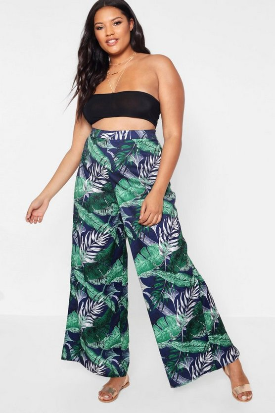 Pantalones acampanados con estampado tropical plus